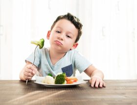 child going to eat vegetables