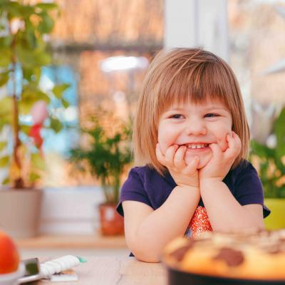 Smiling Young Girl With Healthy Food In Kitchen Web